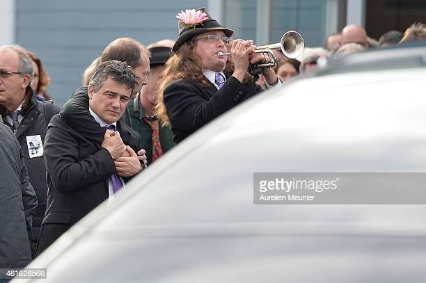Charlie Hebdo journalist Patrick Pelloux gazes into the hearse after the funeral service of Charlie Hebdo editor and cartoonist Stephane Charbonnier...