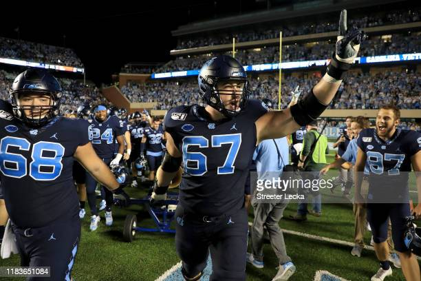 Charlie Heck of the North Carolina Tar Heels celebrates after defeating the Duke Blue Devils 2017 at Kenan Stadium on October 26 2019 in Chapel Hill...