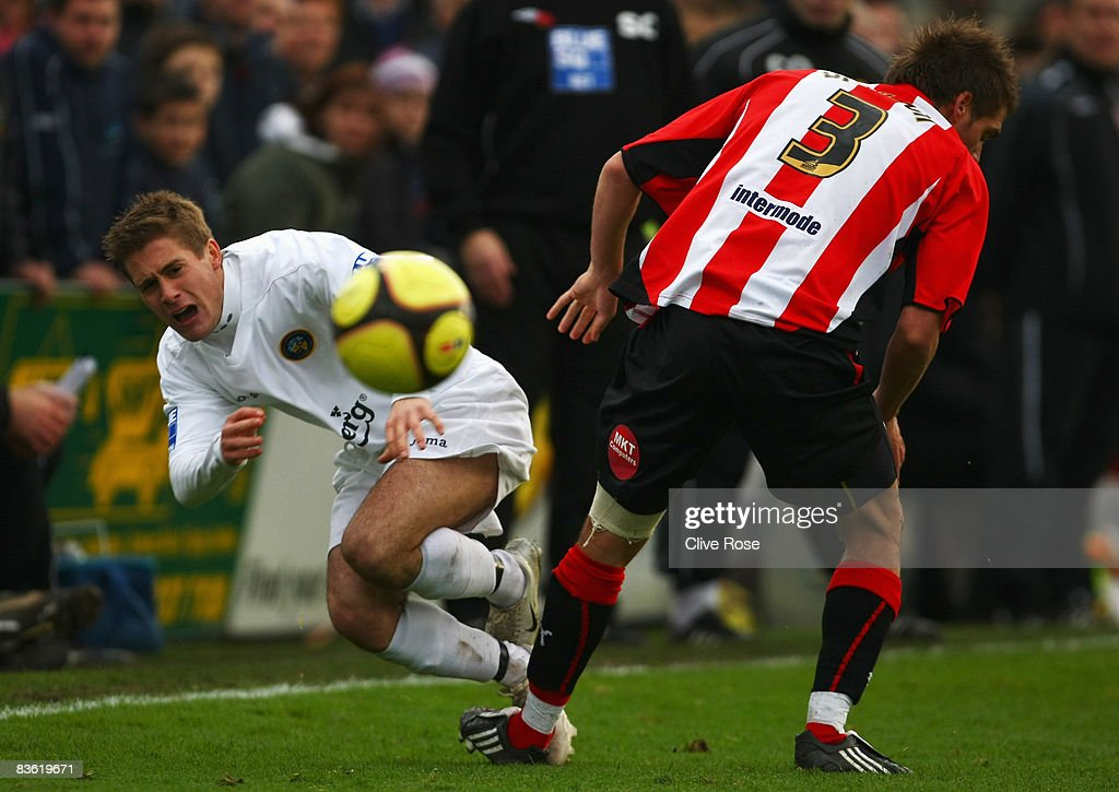 Charlie Henry of Havant & Waterlooville is challenged by Ryan Dickson of Brentford during the FA Cup 1st Round match between Havant & Waterlooville and Brentford at the Westleigh Park on November 9, 2008 in Havant, England.