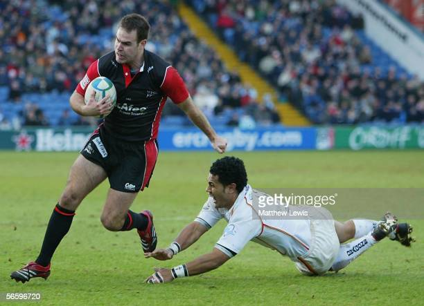 Charlie Hodgson of Sale beats the tackle of Sione Tuipulotu of Newport during the Heineken Cup match between Sale Sharks and Newport-Gwent Dragons at...
