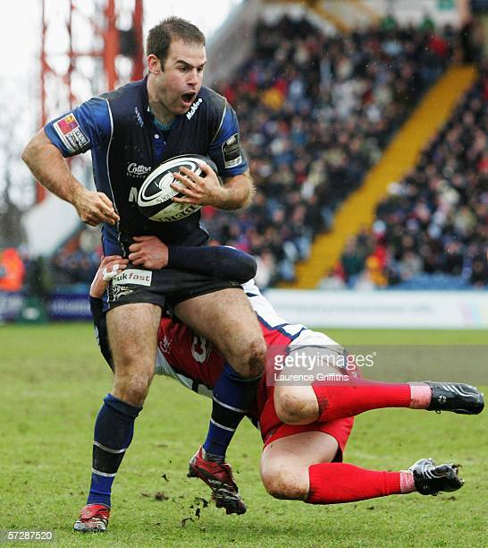 Charlie Hodgson of Sale is tackled by Ludovic Mercier of Gloucester during the Guiness Premiership match between Sale Sharks and Gloucester ar...