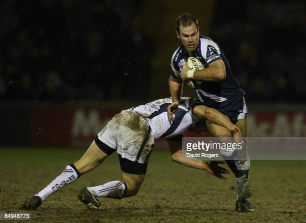 Charlie Hodgson of Sale is tackled by Neil Brew during the Guinness Premiership match between Sale Sharks and Bristol at Edgeley Park on February...