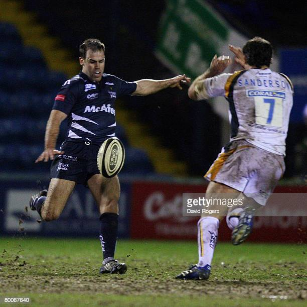 Charlie Hodgson of Sale kicks the ball past Pat Sanderson during the Guinness Premiership match between Sale Sharks and Worcester Warriors at Edgeley...