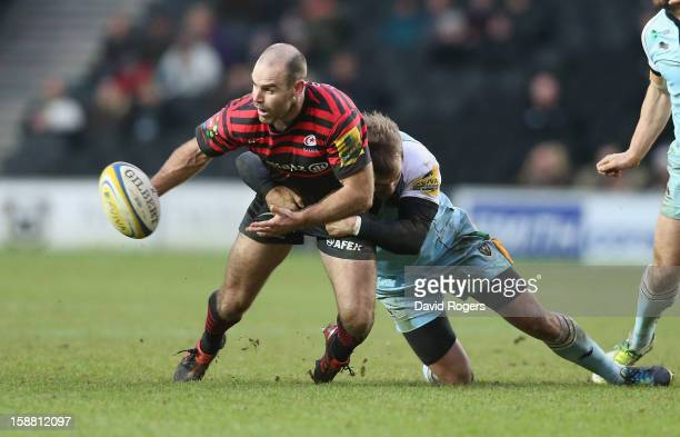 Charlie Hodgson of Saracens is tackled by Stephen Myler during the Aviva Premiership match between Saracens and Northampton Saints at stadiumMK on...