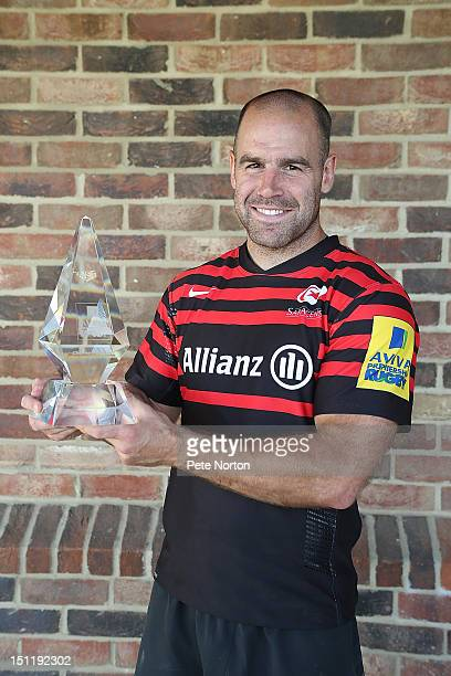 Charlie Hodgson of Saracens poses with his award after scoring 2000 points during a presentation at Old Alanian Sports Club on September 3 2012 in St...