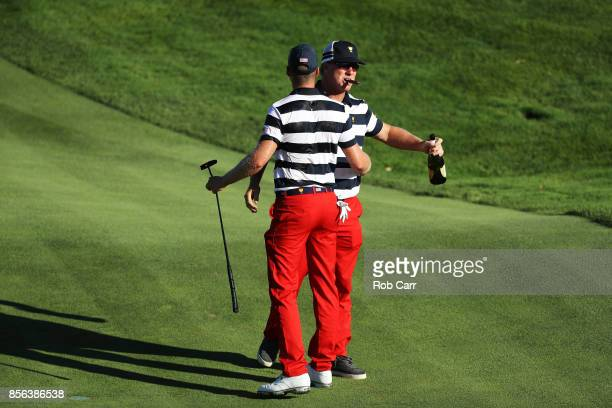 Charlie Hoffman celebrates with Daniel Berger of the US Team after Berger defeated Si Woo Kim of South Korea and the International Team on the 17th...