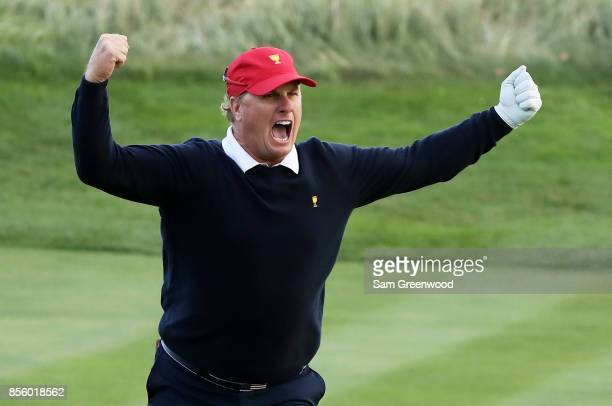 Charlie Hoffman of the U.S. Team reacts after chipping in on the 17th hole during Saturday four-ball matches of the Presidents Cup at Liberty...
