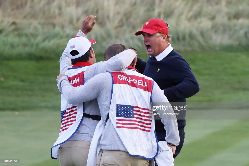 Charlie Hoffman of the U.S. Team reacts after chipping in on the 17th hole during Saturday four-ball matches of the Presidents Cup at Liberty National Golf Club on September 30, 2017 in Jersey City, New Jersey.
