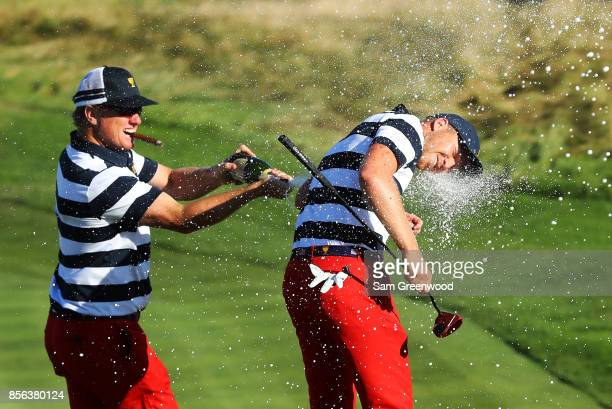 Charlie Hoffman sprays Daniel Berger of the US Team with champagne after Berger defeated Si Woo Kim of South Korea and the International Team on the...
