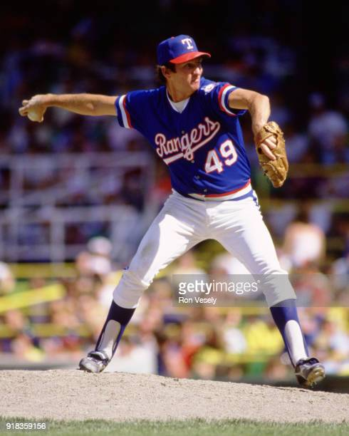 Charlie Hough of the Texas Rangers pitches during an MLB game against the Chicago White Sox at Comiskey Park in Chicago Illinois during the 1989...
