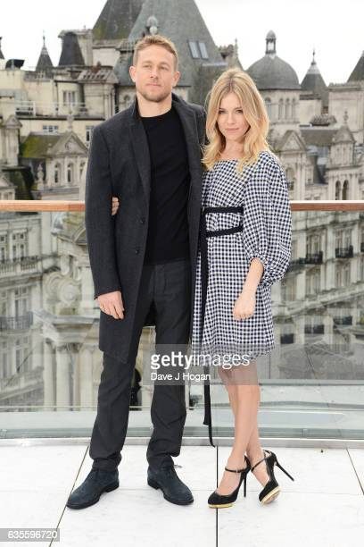 Charlie Hunnam and Sienna Miller pose at a photocall for 'The Lost City Of Z' at Corinthia London on February 16 2017 in London England