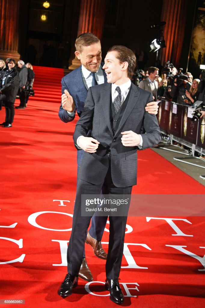 Charlie Hunnam (L) and Tom Holland arrive at The Lost City of Z UK Premiere at The British Museum on February 16, 2017 in London, United Kingdom.