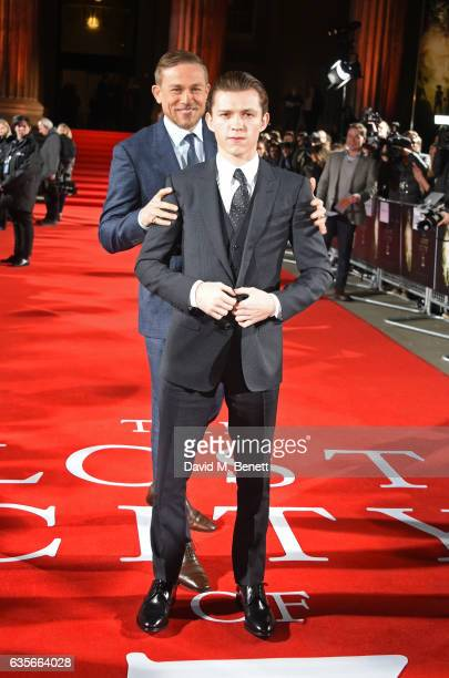 Charlie Hunnam and Tom Holland arrive at The Lost City of Z UK Premiere at The British Museum on February 16 2017 in London United Kingdom