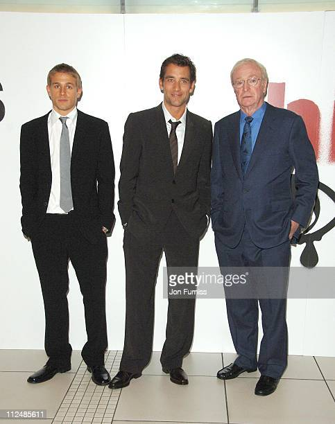 Charlie Hunnam Clive Owen and Michael Caine during The Children of Men London Premiere Inside Arrivals in London Great Britain