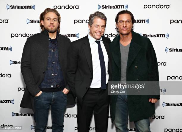 Charlie Hunnam Hugh Grant and Matthew McConaughey pose for a photo as Andy Cohen sits down with the cast of 'The Gentlemen' on his SiriusXM Channel...