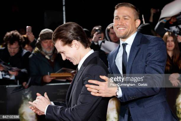 Charlie Hunnam who plays Percy Fawcett has fun with Tom Holland on the red carpet at The Lost City of Z UK premiere on February 16 2017 in London...