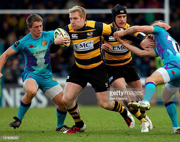 Charlie Ingall of Wasps hands off the tackle of Gareth Steenson of Exeter during the LV= Cup match between London Wasps and Exeter Chiefs at Adams...