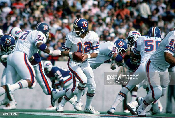 Charlie Johnson of the Denver Broncos turns to hand the ball off against the Buffalo Bills during an NFL football game on October 5 1975 at Rich...