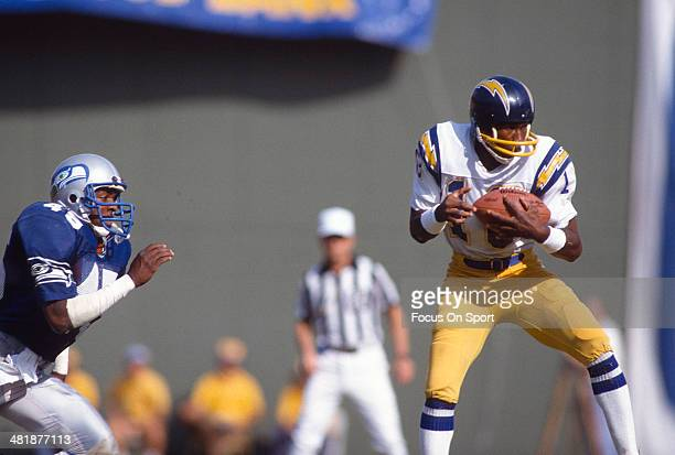 Charlie Joiner of the San Diego Chargers catches a pass against the Seattle Seahawks during an NFL football game October 4 1981 at Jack Murphy...