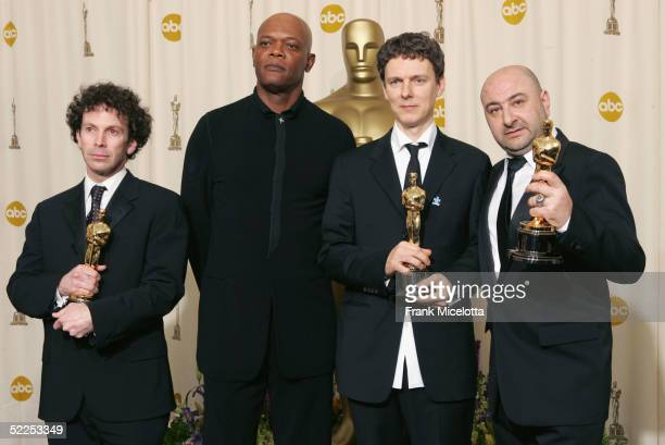Charlie Kaufman Michel Gondry and Pierre Bismuth winners of the Oscar for Best Original Screenplay for Eternal Sunshine of the Spotless Mind pose...