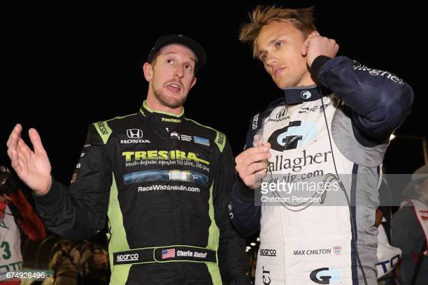 Charlie Kimball driver of the Chip Ganassi Racing Honda and Max Chilton of Great Britain driver of the Chip Ganassi Racing Honda talk on the grid...