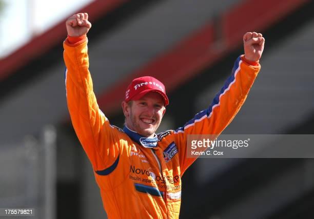 Charlie Kimball driver of the Novo Nordisk Chip Ganassi Racing Honda Dallara celebrates winning the IZOD IndyCar Series Honda Indy 200 at MidOhio...