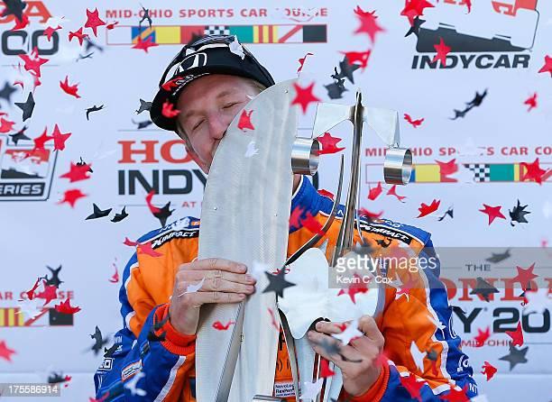 Charlie Kimball driver of the Novo Nordisk Chip Ganassi Racing Honda Dallara kisses the trophy after winning the IZOD IndyCar Series Honda Indy 200...
