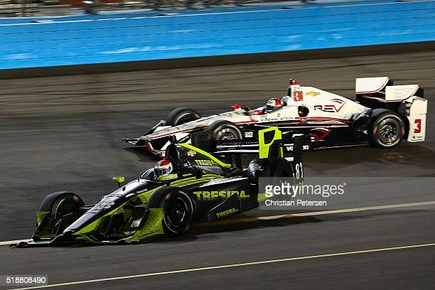 Charlie Kimball driver of the Tresiba Chip Ganassi Racing Chevrolet IndyCar spins out as Helio Castroneves of Brazil driver of the Team Penske...