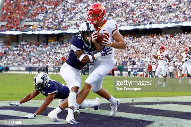 Charlie Kolar of the Iowa State Cyclones pulls in a touchdown pass in the end zone against Vernon Scott of the TCU Horned Frogs and Markell Simmons...