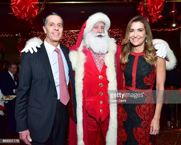 Charlie Krusen Santa Claus and Kristen Krusen attend A Christmas Cheer Holiday Party 2017 Hosted by George Farias and Anne and Jay McInerney at The...
