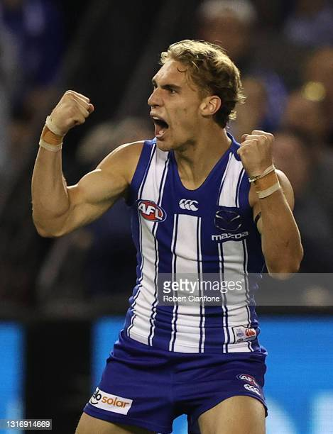Charlie Lazzaro of the Kangaroos celebrates after scoring a goal during the round eight AFL match between the North Melbourne Kangaroos and the...