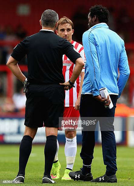 Charlie Lee of Stevenagetalks to referee Iain Williamson and Ugo Ehiogu manager of Tottenham XI after his challenge on Nathan Oduwa of Tottenham XI...