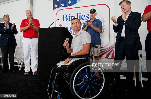 Charlie Lemon, an Army veteran who was wounded in Iraq, addresses the crowd during the Birdies for the Brave charity golf match to benefit veterans,...