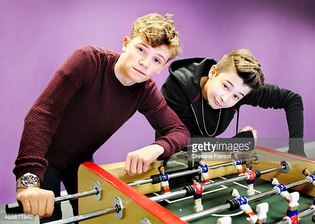 Charlie Lenehan and Leondre Devries of Bars and Melody pose while playing table football backstage before meeting fans and signing copies of their...