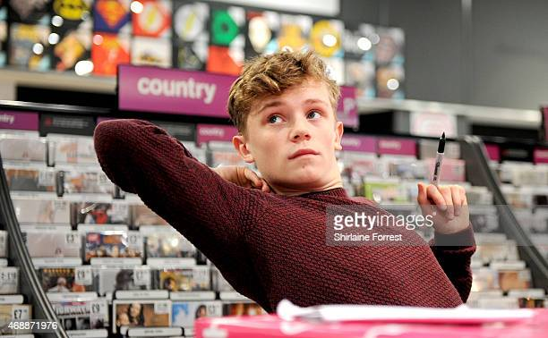 Charlie Lenehan of Bars Melody meets fans and signs copies of their new single 'Stay Strong' at HMV on April 7 2015 in Liverpool England
