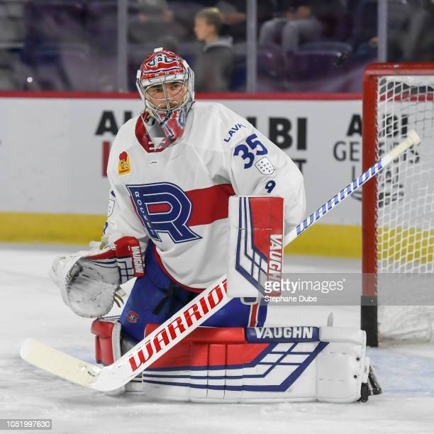 Charlie Lindgren of the Laval Rocket made a stick save against the Binghamton Devils at Place Bell on October 12 2018 in Laval Canada