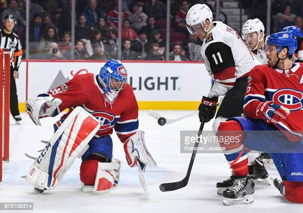 Charlie Lindgren of the Montreal Canadiens blocks the shot from Brendan Perlini of the Arizona Coyotes in the NHL game at the Bell Centre on November...