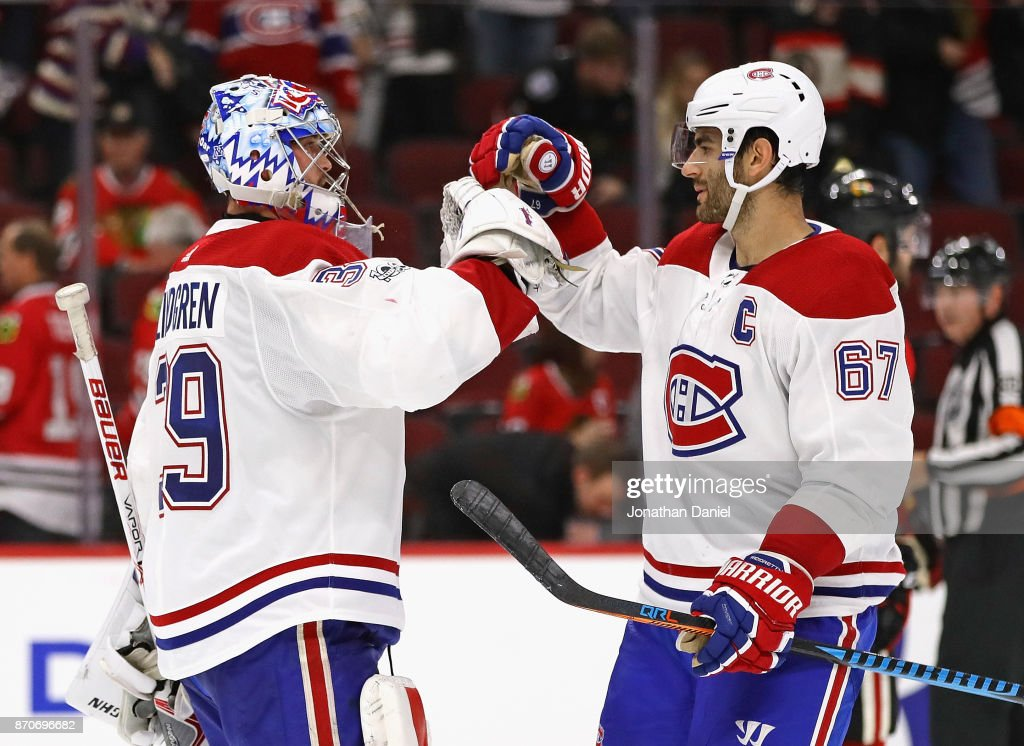 Charlie Lindgren #39 of the Montreal Canadiens (L) is congratulated by Max Pacioretty #67 after a shutout win against the Chicago Blackhawks at the United Center on November 5, 2017 in Chicago, Illinois. The Canadiens defeated the Blackhawks 2-0.