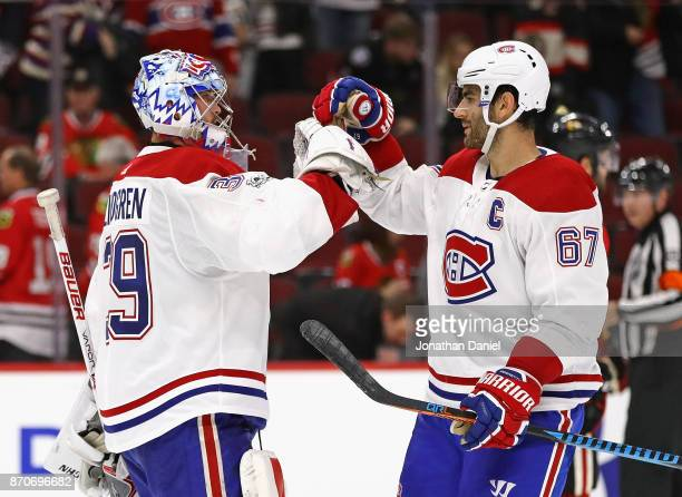 Charlie Lindgren of the Montreal Canadiens is congratulated by Max Pacioretty after a shutout win against the Chicago Blackhawks at the United Center...