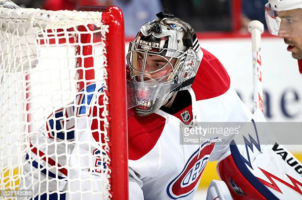 Charlie Lindgren of the Montreal Canadiens keeps his eye on the puck and defends the net during an NHL game against the Carolina Hurricanes at PNC...