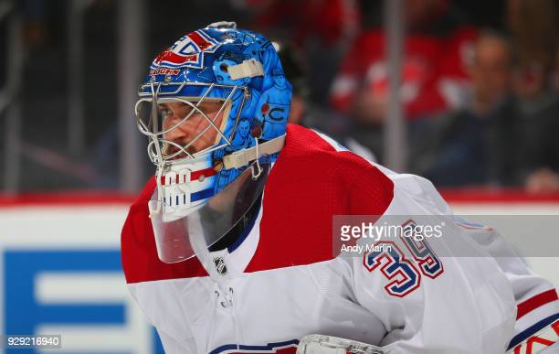 Charlie Lindgren of the Montreal Canadiens looks on against the New Jersey Devils during the game at Prudential Center on March 6 2018 in Newark New...