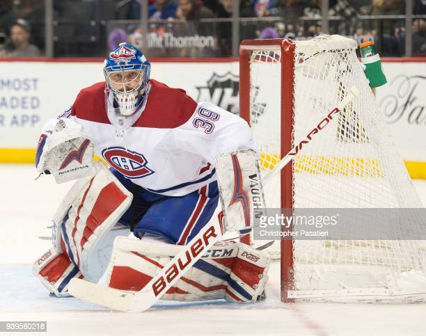 Charlie Lindgren of the Montreal Canadiens looks on as he tends goal during the first period against the New York Islanders on March 2 2018 in New...