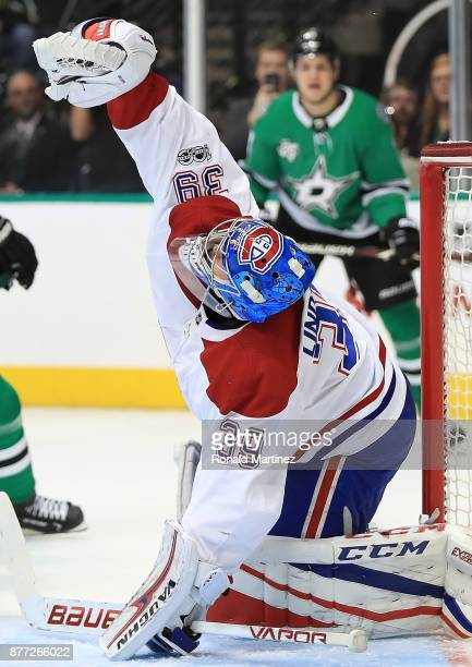Charlie Lindgren of the Montreal Canadiens makes a glove save against the Dallas Stars in the first period at American Airlines Center on November 21...