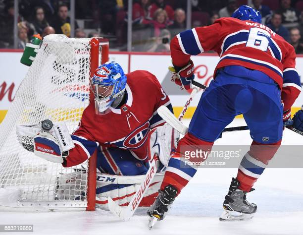 Charlie Lindgren of the Montreal Canadiens makes a glove save against the Toronto Maple Leafs in the NHL game at the Bell Centre on November 18 2017...