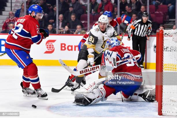 Charlie Lindgren of the Montreal Canadiens makes a pad save near Jonathan Marchessault of the Vegas Golden Knights during the NHL game at the Bell...