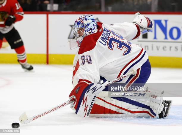 Charlie Lindgren of the Montreal Canadiens makes a save against the Chicago Blackhawks at the United Center on November 5 2017 in Chicago Illinois