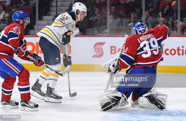 Charlie Lindgren of the Montreal Canadiens makes a save in front of Nathan Beaulieu of the Buffalo Sabres in the NHL game at the Bell Centre on...