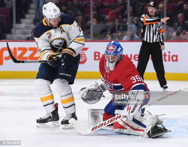 Charlie Lindgren of the Montreal Canadiens makes a save in front of Kyle Okposo of the Buffalo Sabres in the NHL game at the Bell Centre on November...