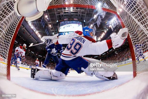 Charlie Lindgren of the Montreal Canadiens reaches with his glove hand against the Toronto Maple Leafs during the first period at the Air Canada...