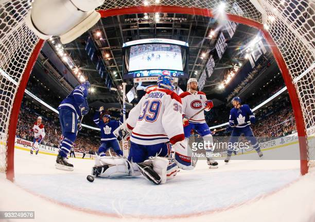 Charlie Lindgren of the Montreal Canadiens reacts after giving up a goal by William Nylander of the Toronto Maple Leafs not pictured as Andreas...